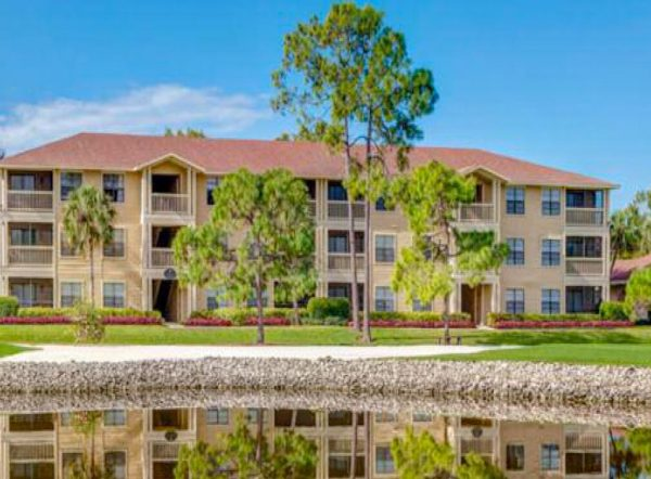 landscaped-lawn-and-lake-outside-apartments